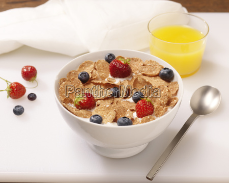 bowl of cereal flakes with berries