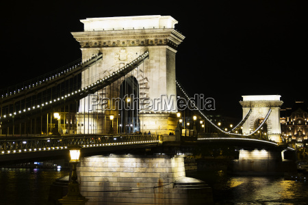arches of szechenyi chain bridge illuminated