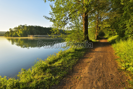 path by river in morning in