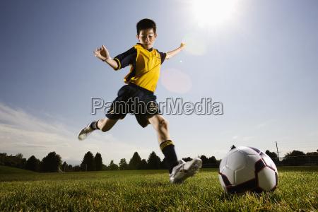 a soccer player a boy preparing