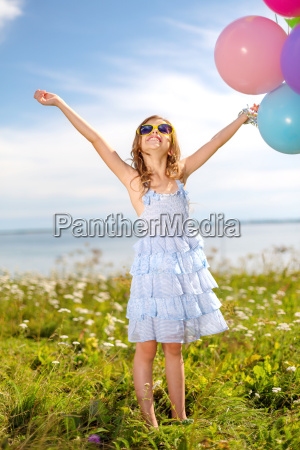 happy girl waving hands with colorful
