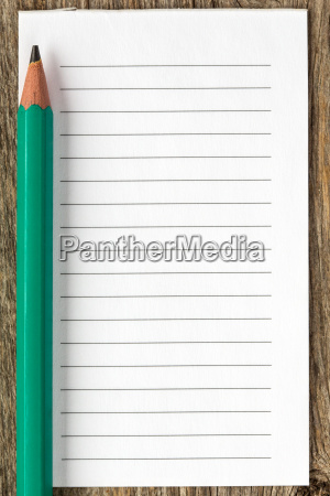 pencil and blank lined paper