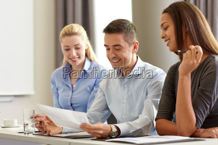 business people with papers meeting in