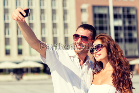 smiling couple in city