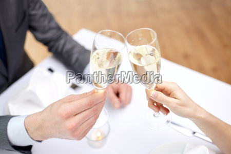 couple with glasses of champagne at