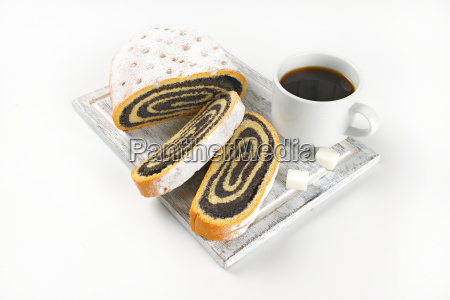 sliced poppy seed roll and cup