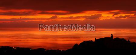coastal city in sunset light