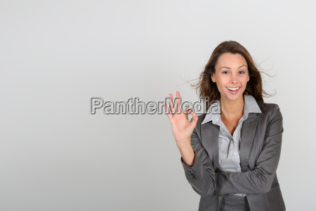 successful businesswoman showing thumbs up