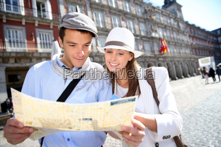 couple of tourists looking at city