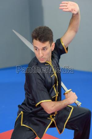 martial arts expert using a sword