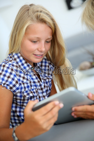 closeup on kids using electronic tablet