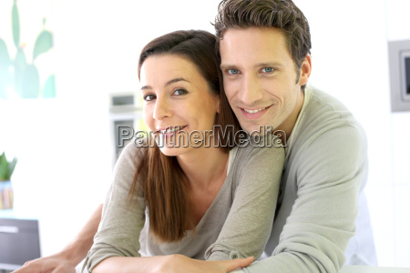 portrait of cheerful couple standing at