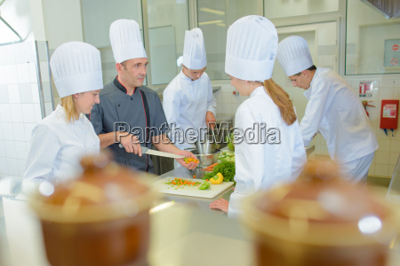 chef teaching students on cookery course