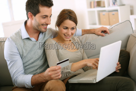 couple using credit card to shop