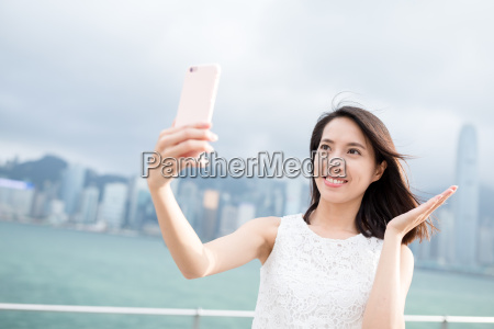 woman taking photo by smart phone