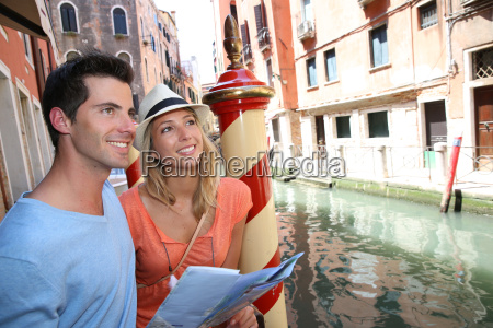 couple of tourists in venice looking