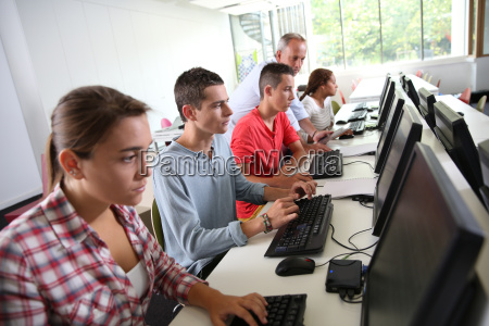 group of young people in computing
