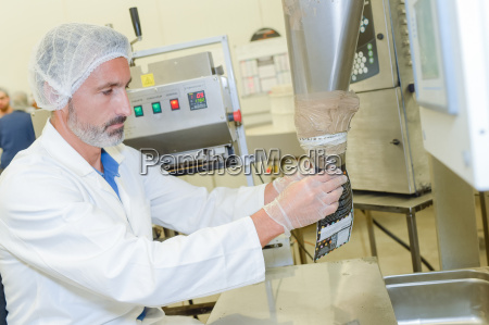 man putting processed food in a
