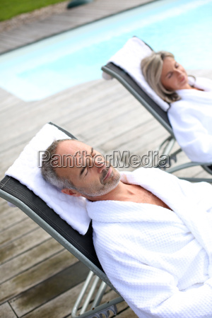 senior couple in spa hotel relaxing