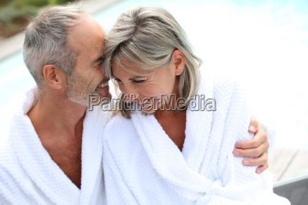 happy senior couple in bathrobe by