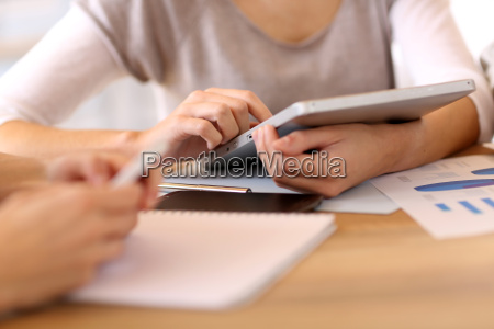 people in office using digital tablet