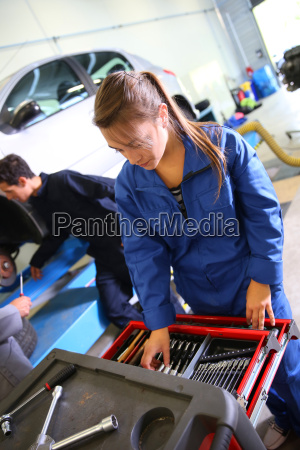 smiling young woman in auto mechanics