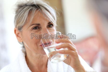 senior woman drinking water in the