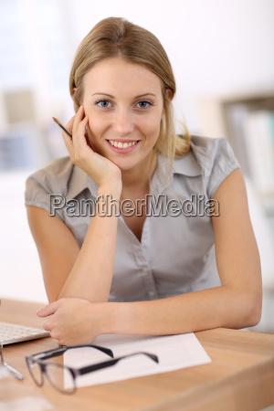 portrait of beautiful office worker sitting