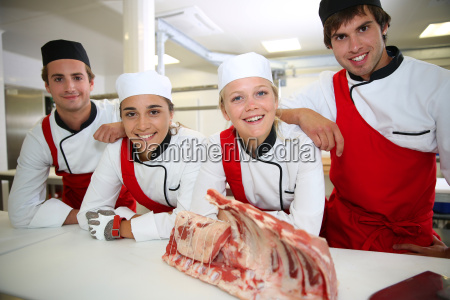 happy team of young butchers in
