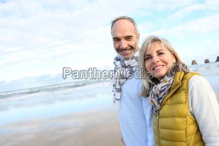 cheerful senior people walking on the