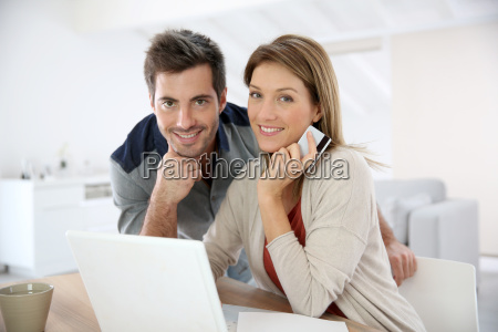 couple at home doing online shopping