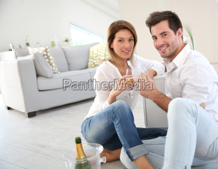 couple at home celebrating new house