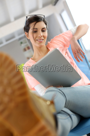 young woman in office relaxing in