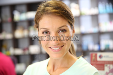 portrait of smiling pharmacist woman in