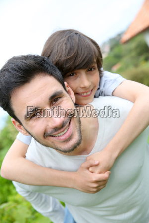 father giving piggyback ride to his