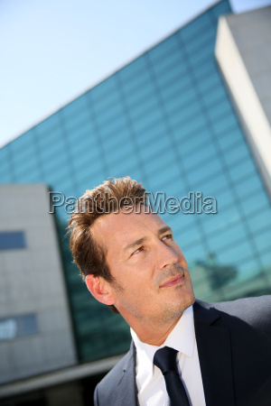 portrait of businessman standing in front