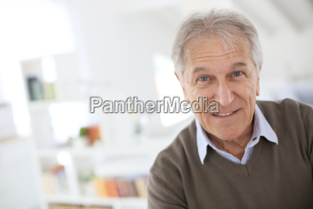handsome senior man standing in modern