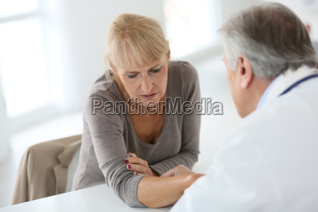 senior woman seeing specialist for diagnostic