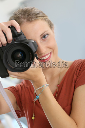 cheerful young woman in photography training