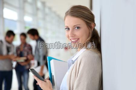 young woman sending short text message