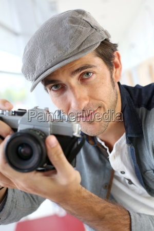 photographer in studio using old fashioned