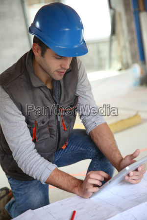builder with blue security helmet using