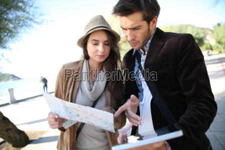 couple on a journey looking at
