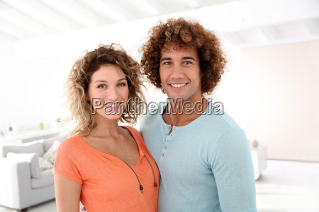 cheerful couple standing in their new