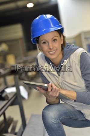 woman engineer in steel plant using