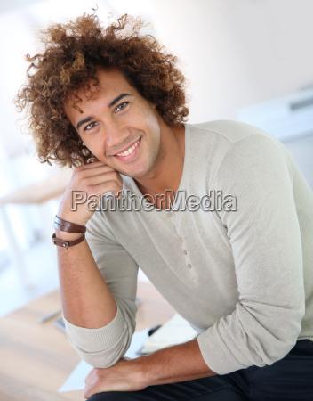 handsome man in modern apartment