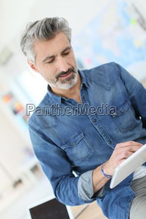 teacher using tablet in university class
