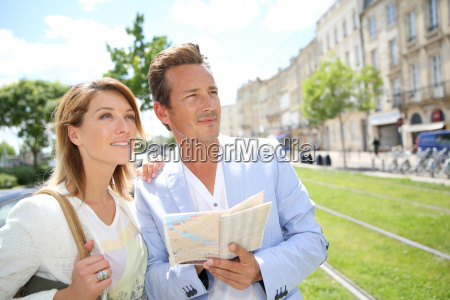 couple in town looking at public