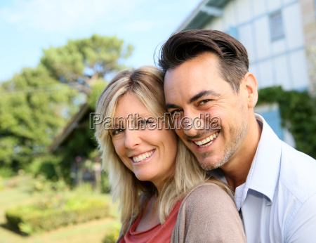 cheerful mature couple standing in front