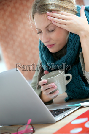 young woman working at home and